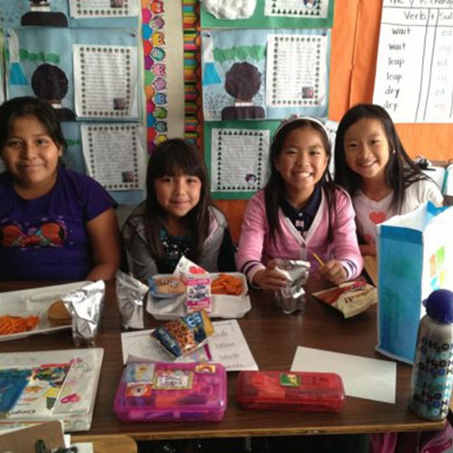 Students enjoy their lunch inside the classroom.